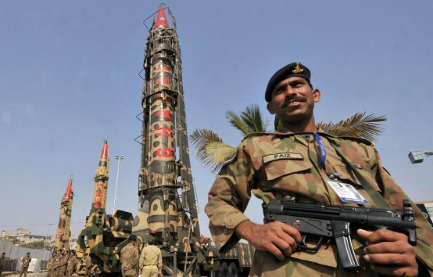 Pakistan soldiers proudly display their nuclear weapons