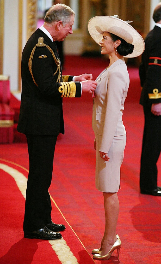 Prince Charles gives Catherine Zeta Jones her CBE