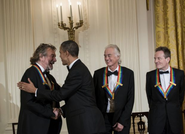 Robert Plant shakes hands with POTUS as Led Zeppelin are honoured at the White House