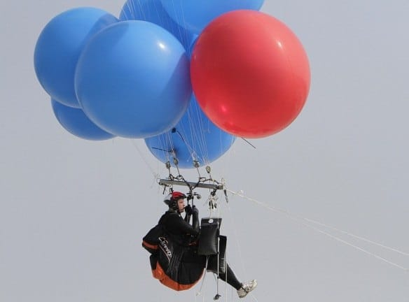 Silver-Vallance floats above the sea using helium filled balloons