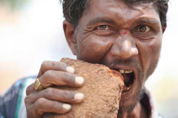 Man eats bricks